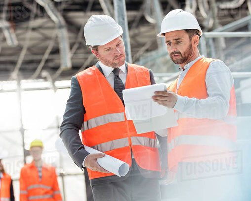 Image two employees discuss about construction liens services and look for a construction lawyer