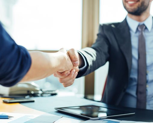 litigation lawyer handshake with a client of employment law service